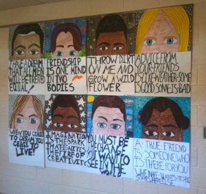 "Image of works created by Fisher Middle School students, self-portraits based on Clarence Carter's work, ""Over and Above"", fall 2010."